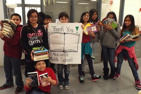 NMS youth with books and thank you sign