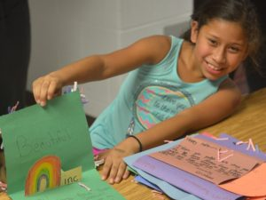 Smiling Young Latino Girl with Handmade Card