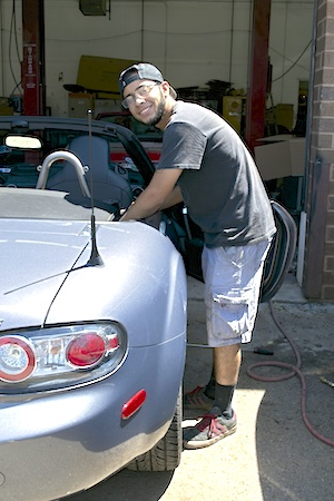 jasser-working-on-a-car