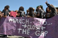 Identity Youth Holding Mach to Close the Gap Banner